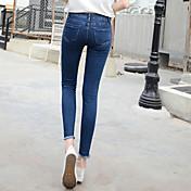 不規則な裾のスリットウエストのジーンズ女性の足ストッキングストレッチ鉛筆のズボンの韓国語バージョンに署名