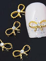 10stk gyldne bowknot 3d legering klar rhinestone nail art dekoration