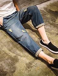 2017 printemps et en été jeunes hommes japonais&# 39; collants neuf points de jeans sarouel trou droit de marée