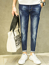 piedini a molla pantaloni jeans uomini coreani vita sottile tasche oblique marea